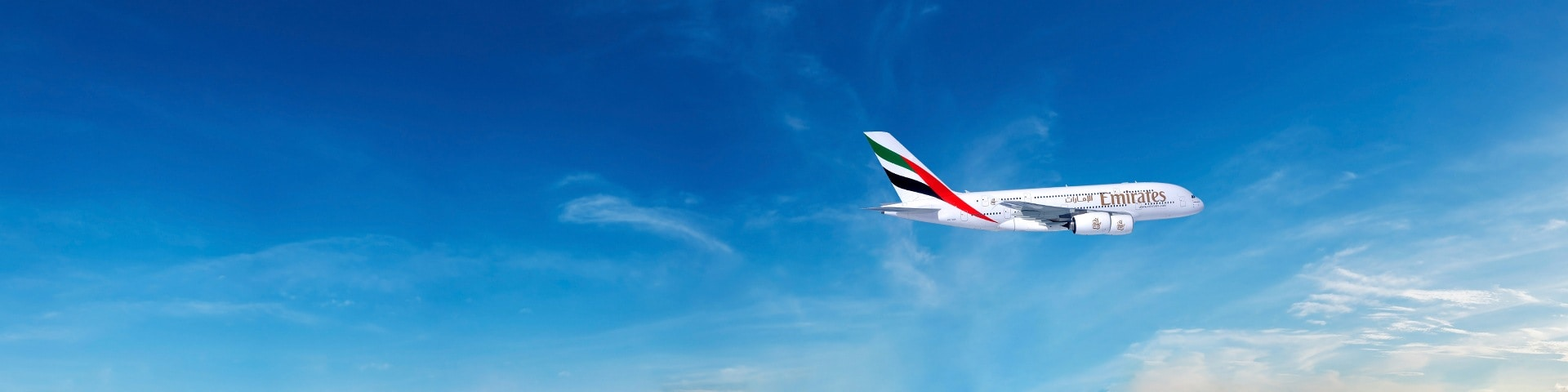 Emirates A380 flying through the clear blue sky