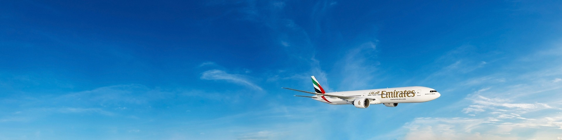 Boeing 777 flying through the clear blue sky