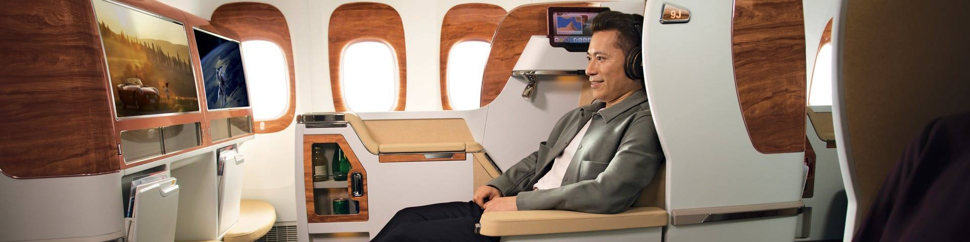 Asian male watching ice-on boeing 777 business