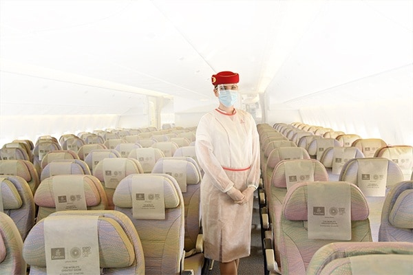 ecl/airport/coronavirus/cabin-crew-on-board-wearing-ppe-d600x400.jpg