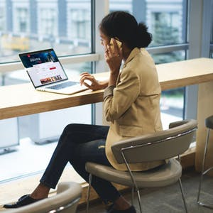 Young executive woman making airline booking online