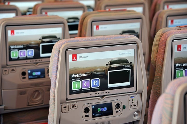 The inflight entertainment screens in Emirates Economy Class on an Emirates A380