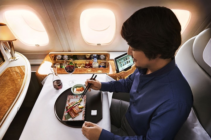 A man enjoys a traditional Japanese meal in Emirates First Class