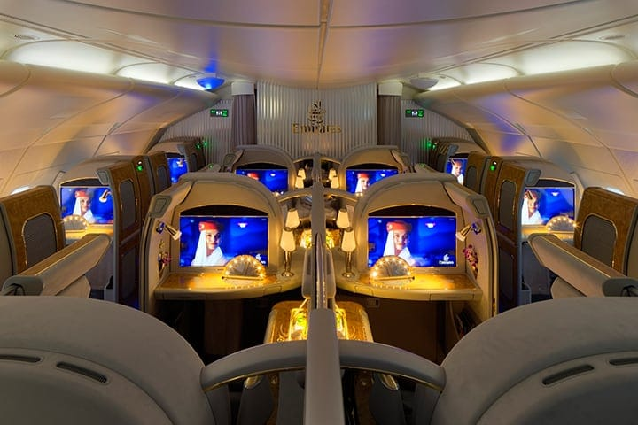 A view of the First Class private suites and entertainment screens in First Class on an Emirates A380